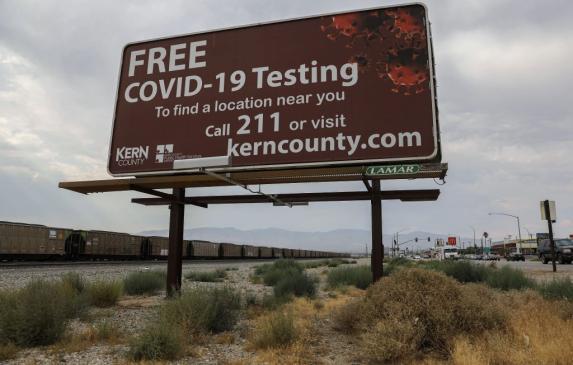 A billboard displays COVID-19 testing information in in Kern County, which has had one of the highest COVID-19 infection rates b