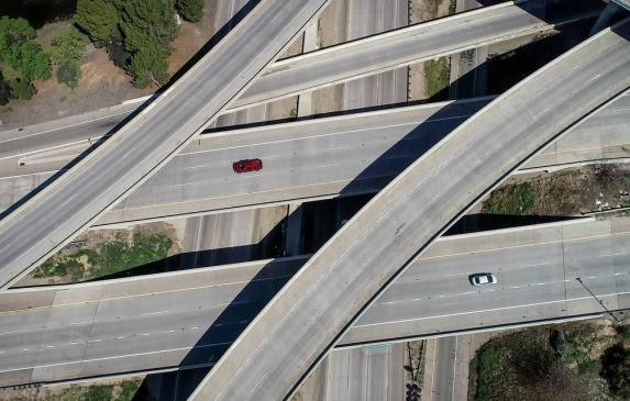 The Highways 41/180 interchange in Fresno appears nearly devoid of cars at around noon on Friday, March 27, 2020. Much of the ci