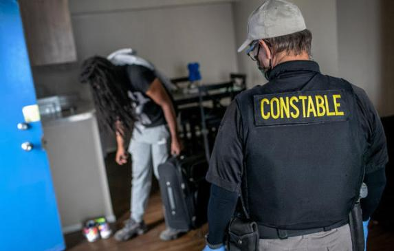 A Maricopa County constable evicts an apartment resident for nonpayment of rent in Phoenix, Arizona.