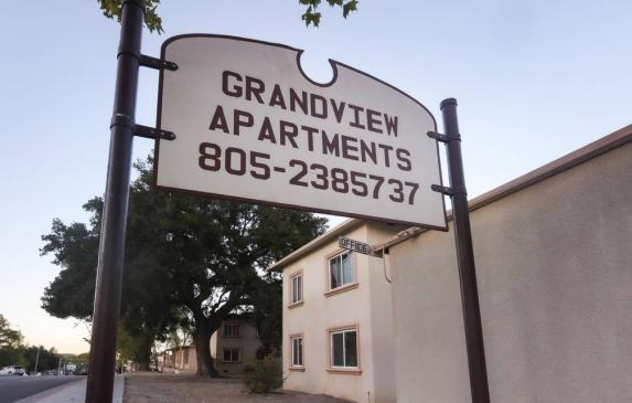 The sign that used to mark the entrance to Grand View Apartments, where hundreds of renters lived with poor conditions for years