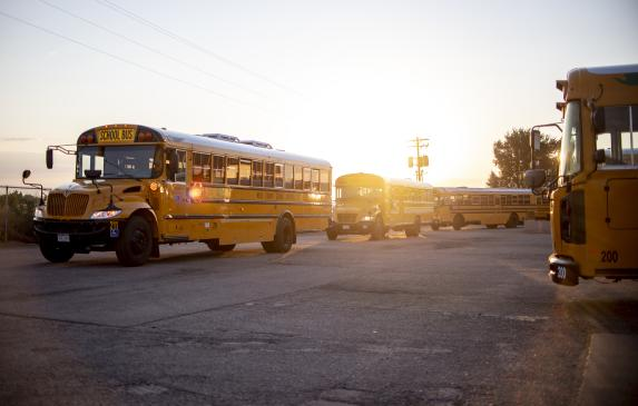 Buses head out on their morning routes at the Greeley-Evans School District 6 Fleet Maintenance Center in Greeley Aug. 19, 2020.