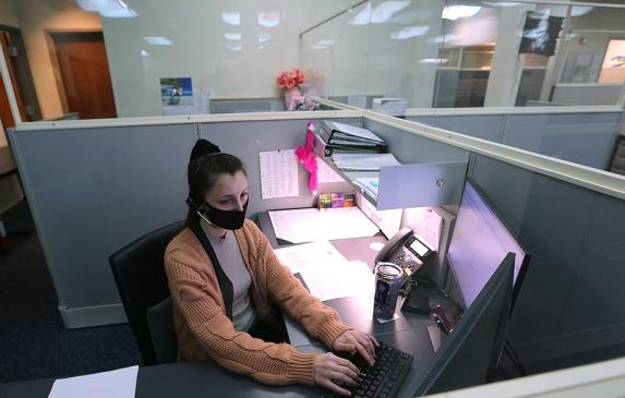 Arkansas child abuse hotline operator Brittany Irby works on abuse reports at her workstation on Jan. 27