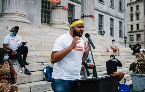 Larry Malcolm Smith Jr. spoke about his experience in the foster care system at a march for Black foster youth.