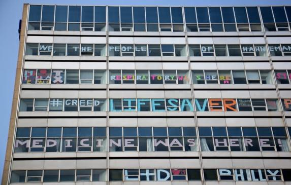 Hahnemann Hospital windows are decorated by employees as the hospital prepares to close.