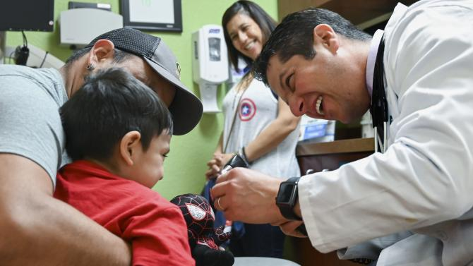 Dr. Ilan Shapiro with a patient at AltaMed Medical in Whittier, east of downtown Los Angeles.