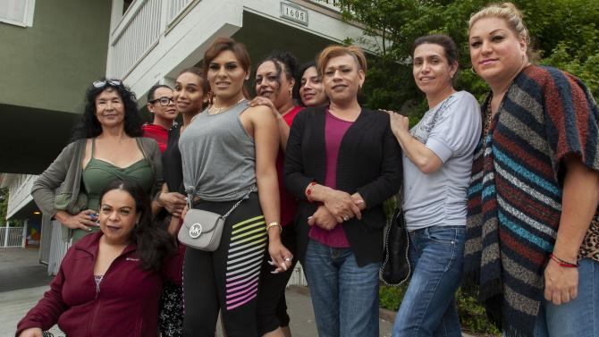 Transgender women stand in front of the LGBT Center OC in Santa Ana on Tuesday, June 25, 2019.