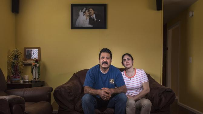 Eduardo and Maria Contreras sit in the living room of their mobile home in San Juan Capistrano on Wednesday, March  20, 2019. Th