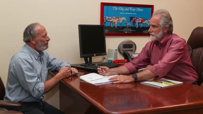 Steve Isen, 64, consults with insurance agent Bill Youngblood.